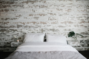 A paneled wall is a great backdrop to a simple bed.