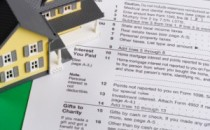 House-on-tax-forms-300x199.jpg
