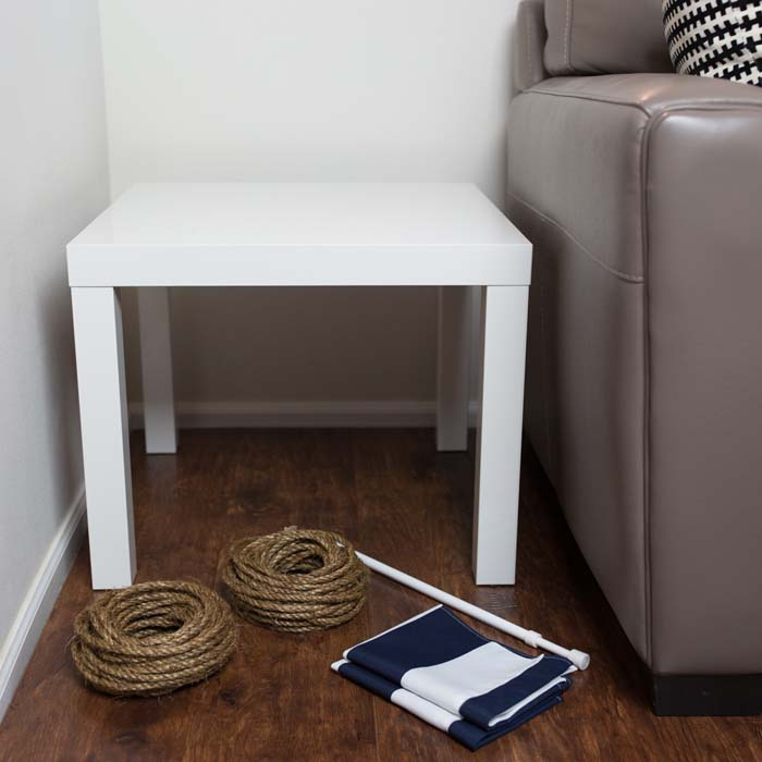 Wrap the rope around the table's front legs to cover them and create a DIY  scratching post.