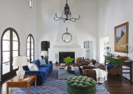 A reupholstered blue couch stands out in the all-white room.  Source: Orlando Soria