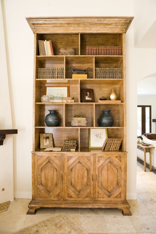 Antique books and found items create visual interest.