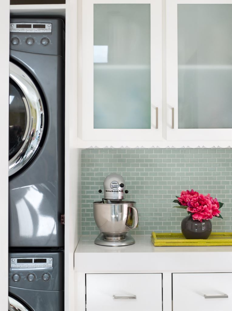 A stackable washer and dryer consolidates room.