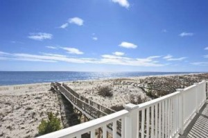 This 3-bedroom Westhampton Beach home is right on the beach with views of the bay.