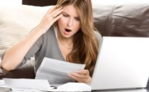 Woman-stressing-over-bills-300x211.jpg