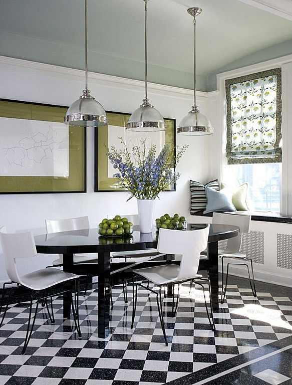 Black and white tiled flooring is a modern addition to this kitchen designed by Jessica Lagrange Interiors.