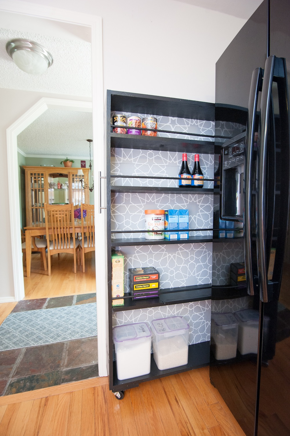 The space saving rolling pantry a diy tutorial build realty for Diy rolling pantry shelves