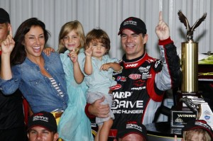 eff Gordon celebrates in victory lane with his wife Ingrid Vandebosch, daughter Ella Sofia and son Leo Benjamin after winning the NASCAR Sprint Cup Series auto race in August 2012. Source: Yahoo!
