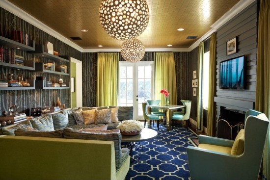 Designer John Wiley's eclectic living room includes gold wallpaper on the ceiling.