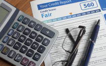 Credit report with score on a desk; Shutterstock ID 243901528